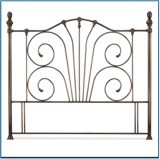 Intricate antique nickel headboard with a curved top railing and spiral design.