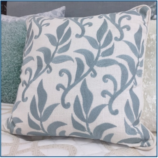 Embroidered leaf scroll design cushion cover in duck egg blue.