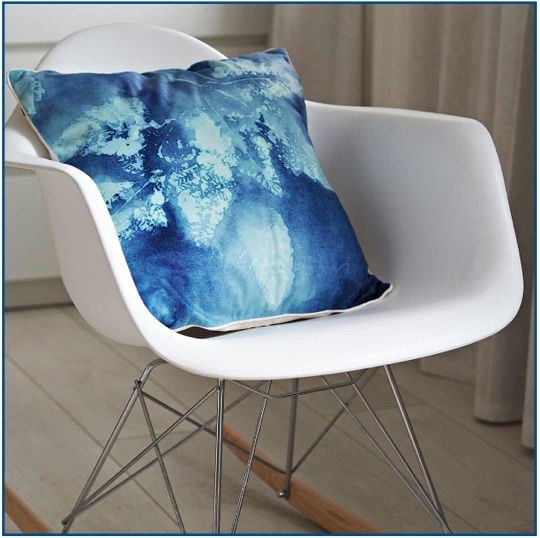 Abstract leaf design cushion cover in a selection of blue tones