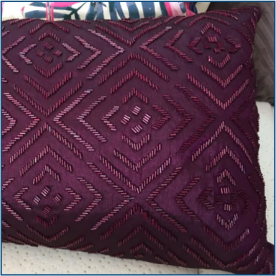 Purple cushion cover with beaded design