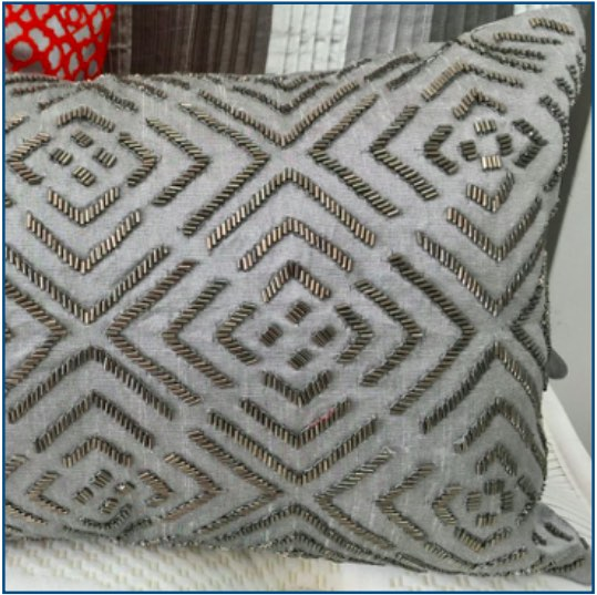 Silver cushion cover with beaded design