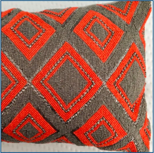 Silver and orange beaded cushion cover