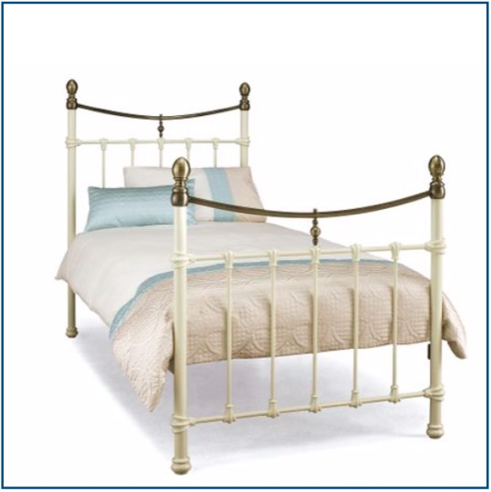 Traditional ivory bedstead with bronze detailing