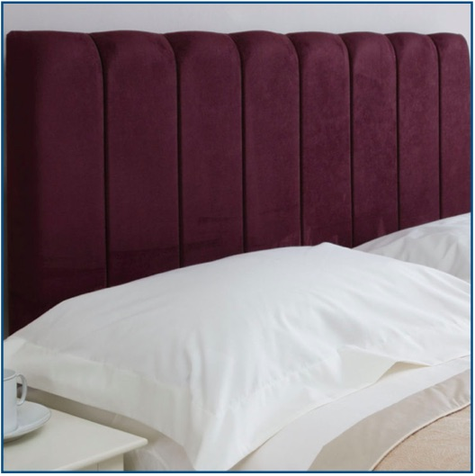 Tall purple upholstered headboard with vertical panels