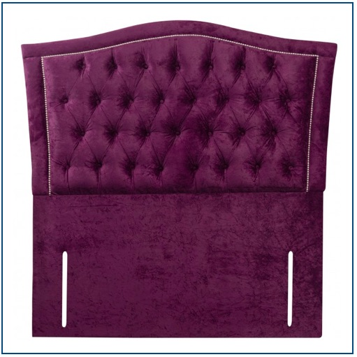 Purple curved upholstered floor standing headboard with button and stud detailing