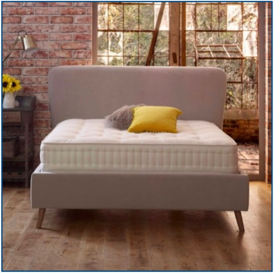 Neural retro design upholstered bedstead with an oversized surround and rounded headboard.