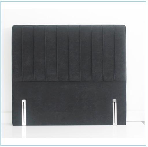 Dark grey upholstered vertically panelled, hand piped floorstanding headboard