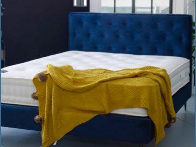 Deep blue upholstered buttoned bedstead