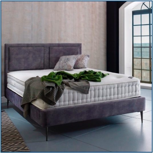 Grey upholstered dual panelled bedstead