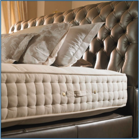 Buttoned and diamond pleated leather bedstead