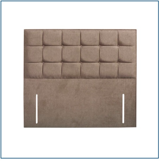 Beige upholstered floor standing headboard with squared detailing and buttons.