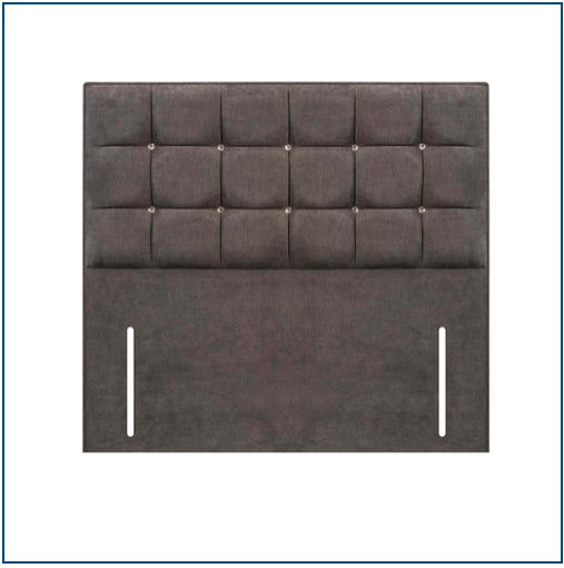 Grey floor standing upholstered headboard with squared detailing accentuated with diamanté studs