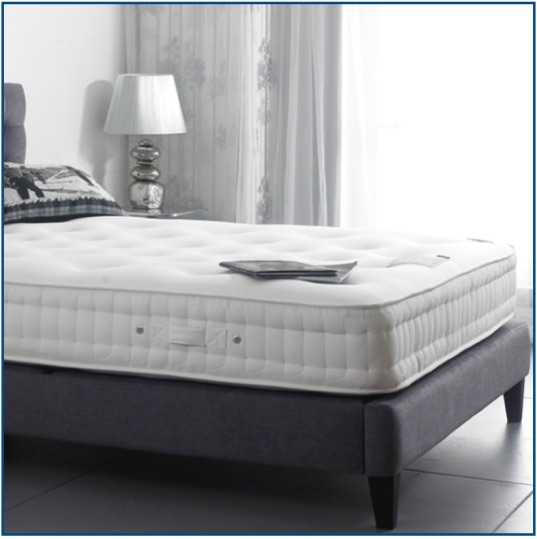 Grey upholstered modern design bedstead with hand sewn squares and button detailing