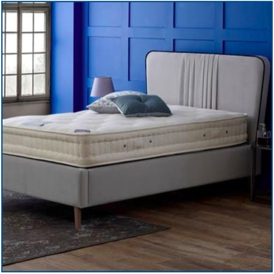 Grey Art Deco inspired upholstered bedstead with pleated detailing and contrast piping