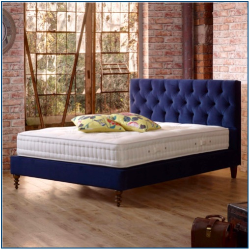 Blue velvet, buttoned and pleated upholstered bedstead