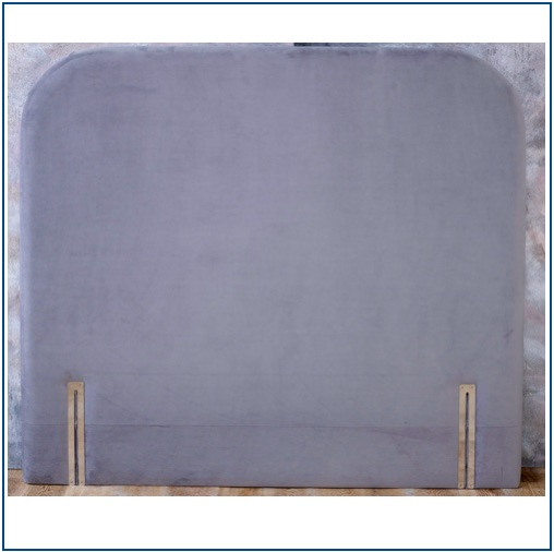 Grey floor standing upholstered headboard with rounded corners