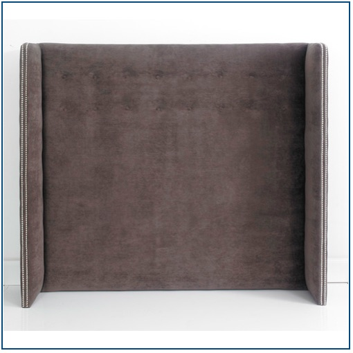 Grey winged, upholstered floorstanding headboard with button and studs