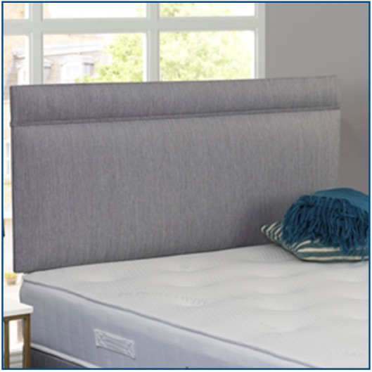 Grey upholstered rectangular shaped strutted headboard with piped detail