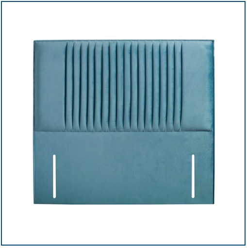 Teal, upholstered floor standing headboard with narrow, vertical panels of fabric decorating the centre