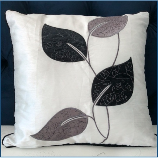 White background, black and silver leaf design cushion cover
