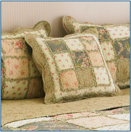 Cream patchwork cushion cover with a dainty rose design