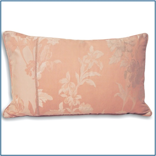 Pink cushion cover with shiny, delicate floral design