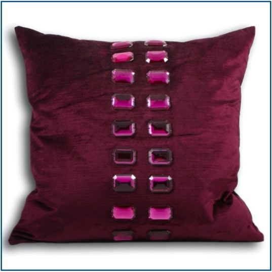 Magenta cushion cover with two rows of purple rhinestones