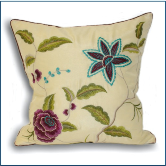 Cream cushion cover with green, blue and purple botanical design