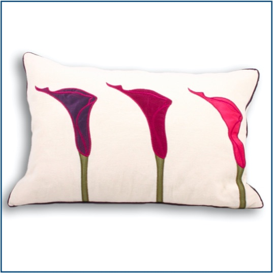Rectangle cream cushion with lily design in pink and purple.