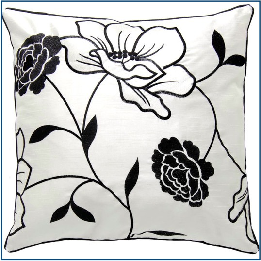 White cushion cover with black and white floral design