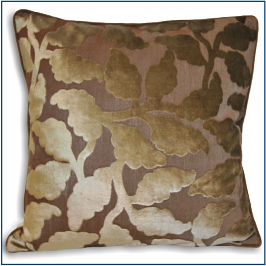 Mink colour cushion cover with leaf design.