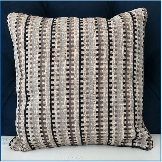Neutral toned, textured stripe cushion cover