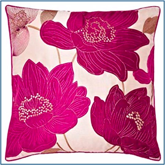 Cream cushion cover with bright magenta flowers