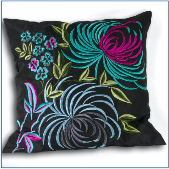 Black cushion cover with bright tropical design