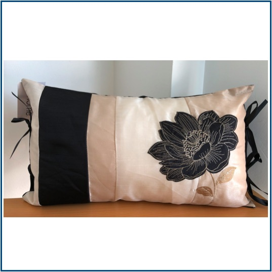 Rectangular shaped black and gold cushion cover with black lotus flower