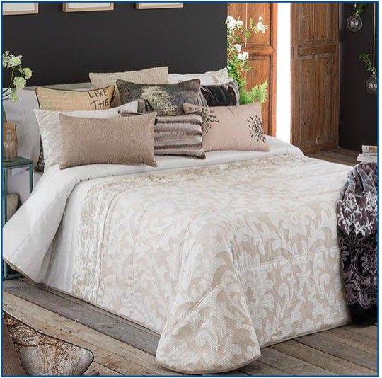Neutral bedspread with filigree design and velvet stripe