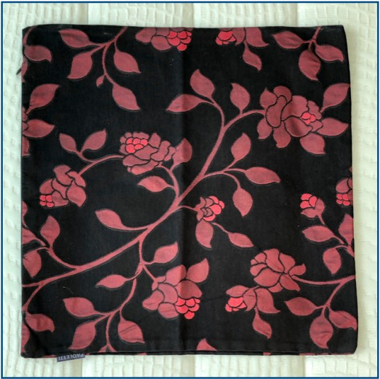 Matte black red cushion cover with vine design