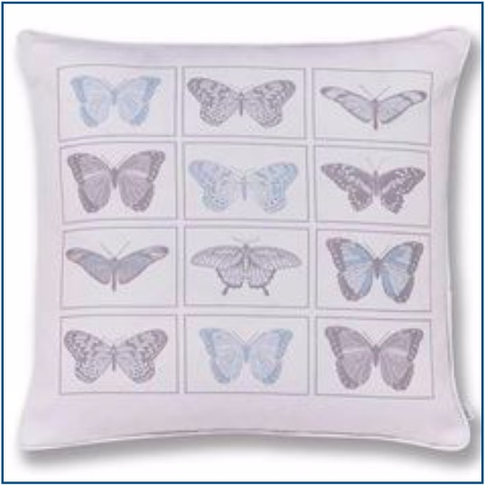White cushion cover with blue and grey butterflies