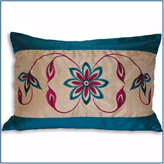 Rectangular, teal cushion cover with teal and purple flower and leaf pattern.