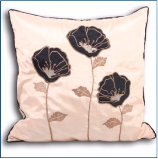 Gold cushion cover with three black and gold poppies