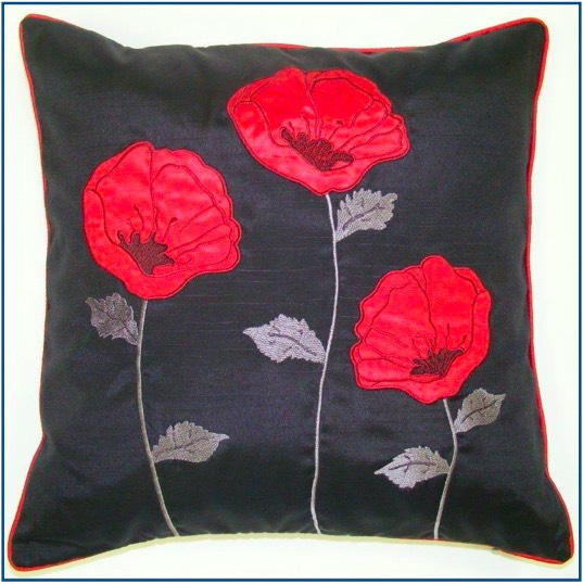 Black cushion cove with three red poppies