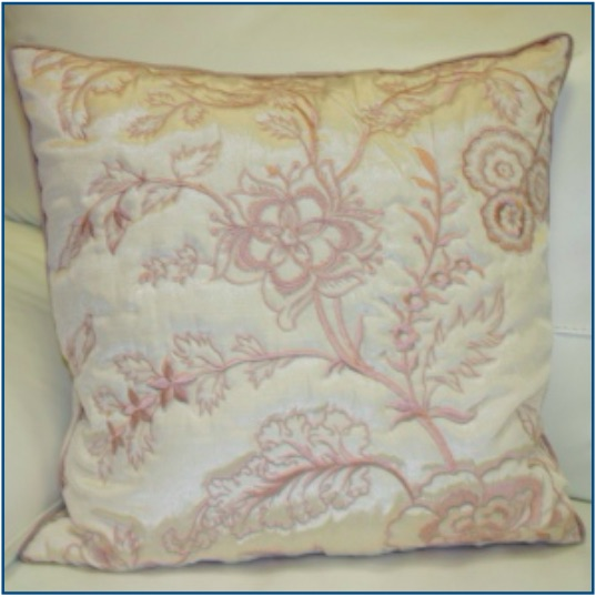 Ivory cushion cover with soft pink floral design and piped edge