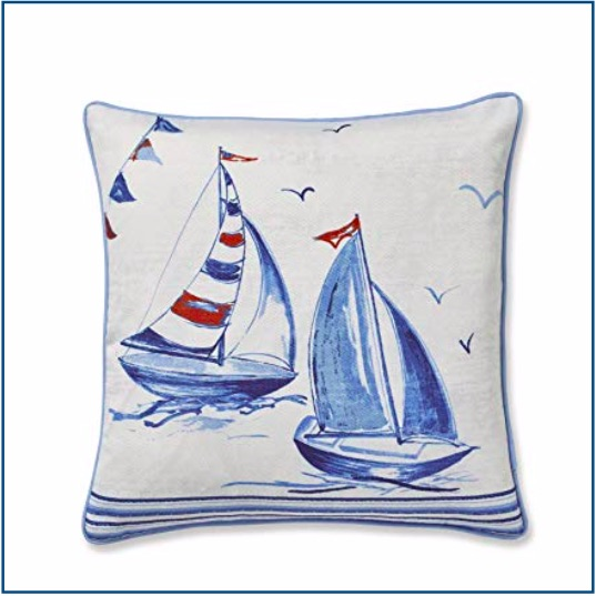 Nautical themed white cushion cover with blue and red sailing boat design