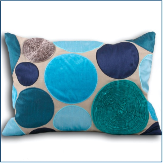 Rectangle, textured spotted cushion cover in different shades of blue