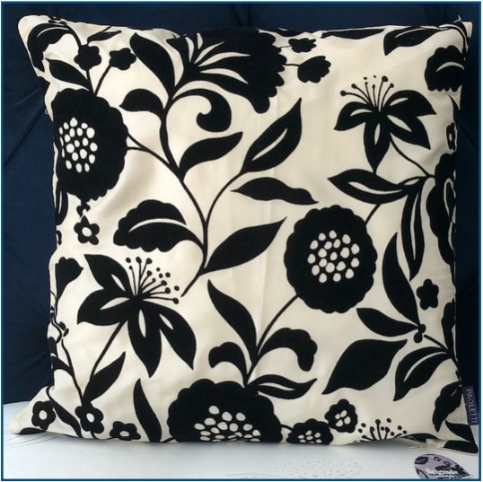 Ivory cushion cover with black velvet floral design