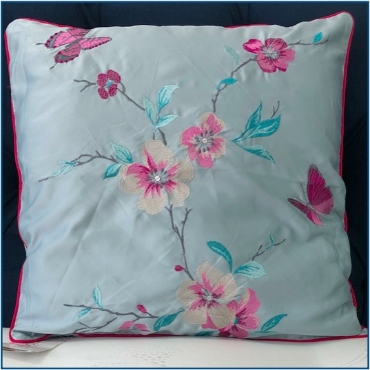 Duck egg blue cushion cover with embroidered pink cherry blossom and butterfly design