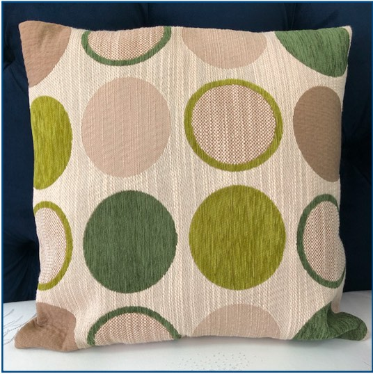 Beige cushion cover with green circle design