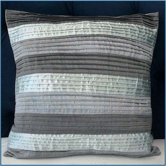 Textured striped cushion cover in different tones of grey
