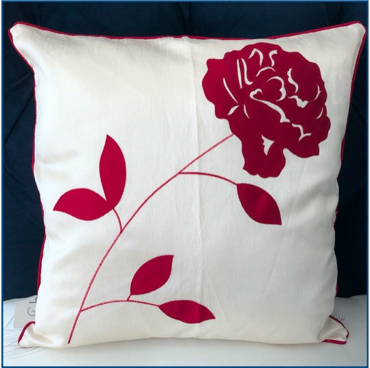 Ivory cushion cover with magenta flower