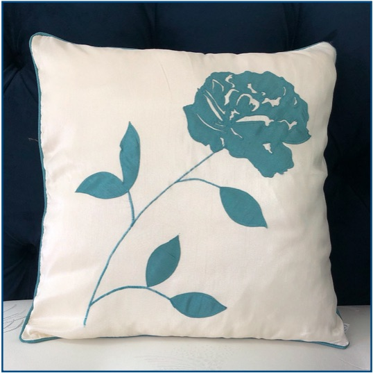 Ivory cushion cover with teal flower